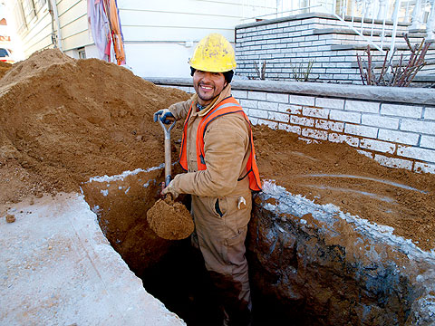 sewer and water main worker