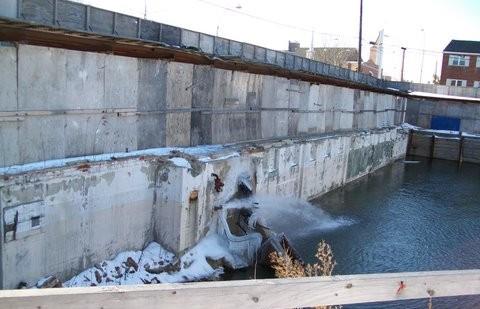 broken water main flooding a basement
