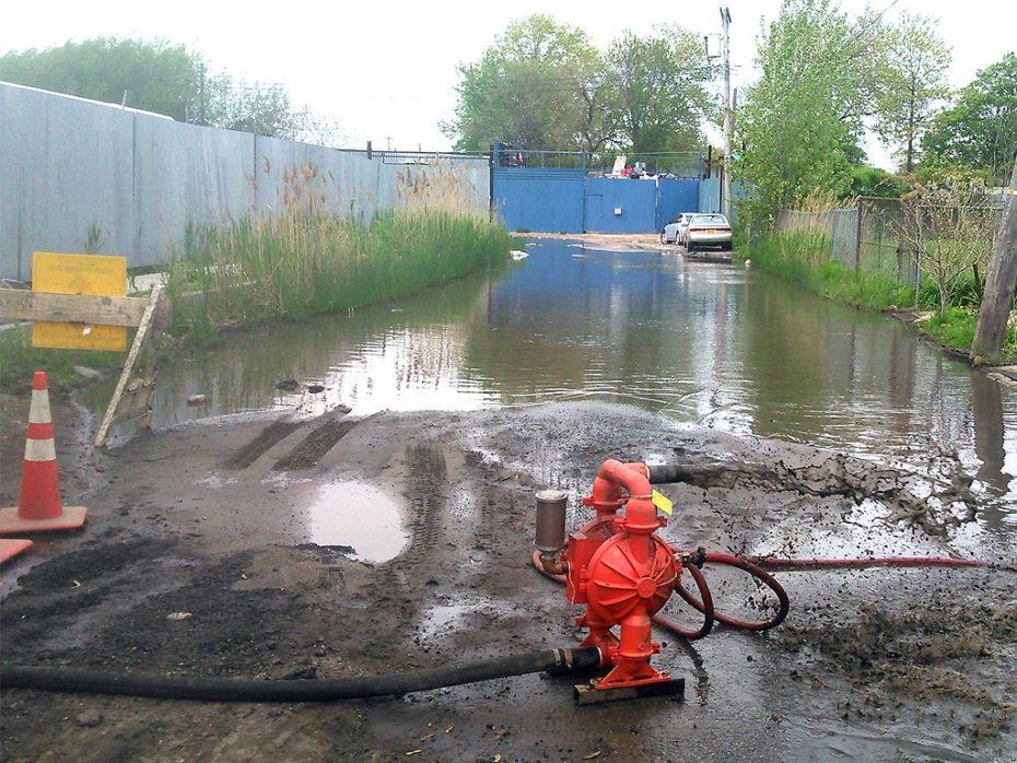 Queens Water Main Break Pumping Water