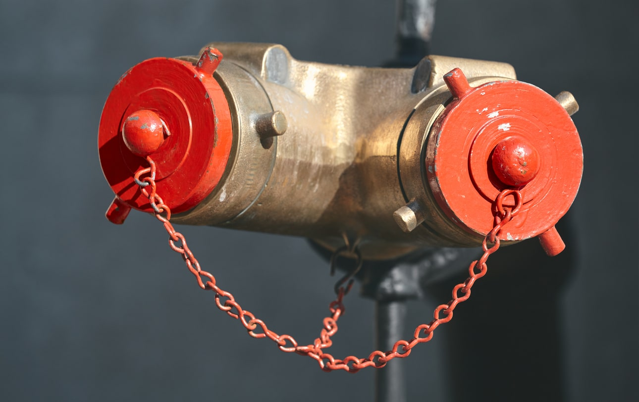 A standpipe of a property building showing a Siamese connection.