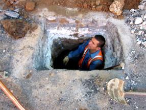 worker inside hole